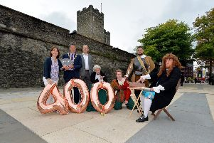 Aideen McCarter, Head of Culture, Derry and Strabane District Council, Mayor John Boyle, Ronan McHugh, Historic Environment Division, DOE, and members of the Footsteps Theatre company pictured in Guildhall Square at the recent launch of 'The Walled City 400 Years'  events. 2019 will be the 400th anniversary of when Derry's historic walls were officially declared complete. DER3618GS073