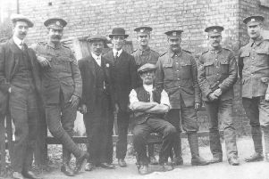 Ian provided this picture  taken in late 1914 somewhere in Peterborough.  He said: 'I suspect the location would be somewhere in the Eastgate area that was demolished in the 1960s & 70s but would be grateful for any insight that readers may be able to offer. From what I know the people on the photograph are from left: Not Known, Not Known (although the cap badge is either East Lancs or Suffolk Regiment), Not Known, William Clark, Harry Clark, Charles Clark, John-Robert Clark, Fred Clark. Seated  is George Clark, the brothers' father (Ian's great grandfather). The missing brothers are George Culpin (could be one of the unknowns although not the uniformed Sergeant) and Jim (he joined 19th January 1915).