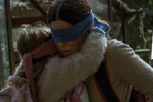 BIRD BOX . . . . Directed by Susanne Bier, starring  Sandra Bullock, Trevante Rhodes, Sarah Paulson, John Malkovich and Jacki Weaver. Inset, 'Journal' Film Critic, Sean Coyle.