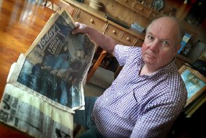 Former Melton police officer Phil Frier looks through the scrapbook he has kept with press cuttings from the Kegworth air disaster, where he was involved in the rescue effort in 1989 EMN-190901-092354001