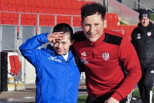 Adam Morrison pictured alongside his favourite player Conor McDermott, before training got underway on Sunday morning.