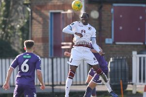 Temi Eweka wins a header during Hastings United's 1-1 draw at home to Guernsey. Picture courtesy Scott White