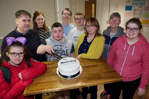 Jack Mooney cutting the cake on behalf of Ardnashee College students who have completed training at 4Rs Recycling. From left are Taylor Healy, Joe Brolly 4Rs Manager, Roisin Keogh 4Rs tutoring assistant, Jack Mooney, Cealan Cleere, Jack Brolly, Joanna O'Boyce Housing Executive, Helena Fox, Ardnashee College, and Jennifer Reddin.(Photo - Tom Heaney, nwpresspics)