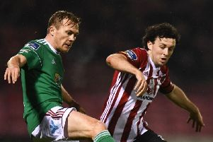 Cork City's Conor McCormack tussles with Derry City skipper Barry McNamee.