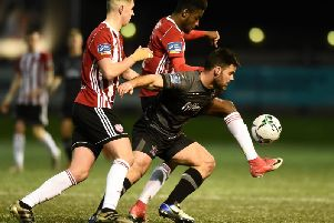 Derry City pair Eoin Toal and Junior Ogedi Uzokwe tussle with Dundalk striker Pat Hoban.