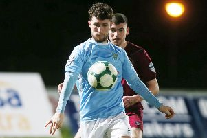 Ballymena United's goalscoring hero Ryan Mayse shields the ball from Institute centre-back Caoimhin Bonner.