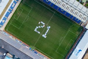 21 Made up from large photographs of people with Down's Syndrome to mark World Down Syndrome Day 2019,'Abax Stadium, Peterborough'Wednesday 20 March 2019. 'Picture by Terry Harris. THA