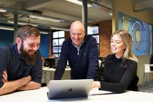 John Harkin (middle) Founder and Director of Alchemy Technology Services with successful recruits from the company's first Academy, Technical Analyst Jordan Cairns and PMO Analyst Olivia Skuce.