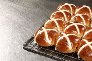 Closeup of Hot Cross Buns on a baking tray