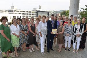 Colr John Boyle, Mayor of Derry City and Strabane, pictured with committee members and staff at the Derry Well Woman's 30th AGM held in 2018, in the Flying Clipper Restaurant.  DER2318GS023