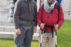 Derry bound Ken Johnston and Daniel Shipp at the start of their walk at Belfast City Hall.