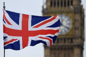 A Union flag flies near the Elizabeth Tower, commonly referred to as Big Ben, at the Houses of Parliament SUS-190124-085849001