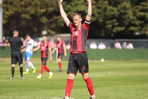Brett Solkhon and his Kettering Town team-mates were able to enjoy a job well done as they claimed a 1-0 win at AFC Rushden & Diamonds. Pictures by Peter Short