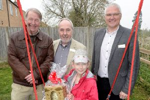 Parish council chair Bill Cook, Derrick Dyas and Richard Mugglestone from WRHA with Easter egg hunt winner Ashlee Muirhead at the new play area. Photo: Paul Nicholls NNL-190418-162700001