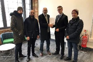 Ansar Ali (centre) handing over the petition against the asphalt plant