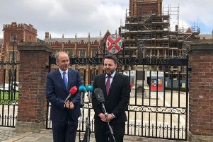 Micheal Martin and Colum Eastwood speaking outside Queen's University Belfast.