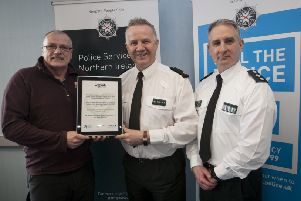 """Robin Young, Foyle Racial Equality Forum and member of the ��We All Belong�"""" campaign pictured presenting Chief Inspector Jonathan Hunter and Chief Inspector Alan Hutton with the A4 size framed pledges at Strand Road PSNI Station last week."""