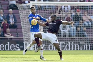 Rangers's Connor Goldson (left) and Hearts' Uche Ikpeazu battle for the ball during the Ladbrokes Scottish Premiership match at Tynecastle Stadium, Edinburgh. PRESS ASSOCIATION Photo. Picture date: Saturday April 20, 2019. See PA story SOCCER Hearts. Photo credit should read: Ian Rutherford/PA Wire. EDITORIAL USE ONLY