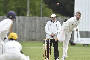 Rob Sayer bowling for Peterborough Town against Horton House. Photo: David Lowndes.