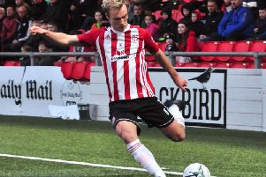 Derry City midfielder, Gregg Sloggett crosses for Junior Ogedi-Uzokwe in the second half.