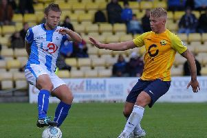 George Dowling (right) pictured playing for Torquay United against Hartlepool United in the Vanarama National League in 2017, is currently on trial at Derry City.