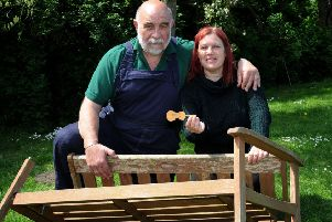 Fairport's Dave Swarbrick's memorial bench was vandalised in Cropredy. A replacement is planned. Blacksmith, Tom Gibbs and Dave's daughter, Issy Swarbrick. NNL-190521-135458009