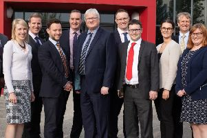 Members of the Bray & Bray team, with Senior Partner Tim Gladdle (centre), at the firm's new offices at Corby Enterprise Centre.