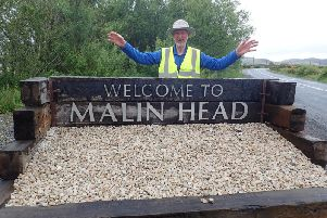 On top of the world.... Brian Brunie reaches Banba's Crown in Malin Head.