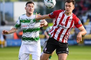 Defender Josh Kerr holds off Shamrock Rovers Aaron Greene, during his last game for Derry City, on Saturday.