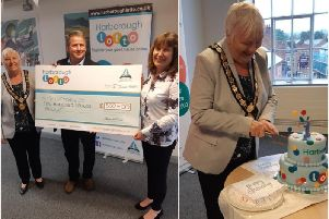Left, Shopmobility pick up a cheque for 500. Right, Cllr Barbara Johnson cuts the birthday cake.