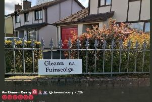 An Dream Dearg's tweet shows the sign that has been erected on the fence of a house at Ashdale, Randalstown.