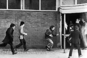 People running for cover on Bloody Sunday (PA/PA Wire)