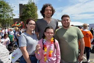 Gary Lightbody from Snow Patrol  with Christina and Caroline Watson and David McEvoy at the Learning Disability Pride parade in Carrickfergus. INCT 22-003-PSB