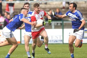 Derry's Enda Lynn with Laois' Patrick O'Sullivan and Gareth Dillon