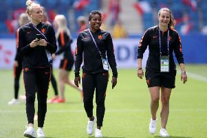 LE HAVRE, FRANCE - JUNE 11: Danique Kerkdijk, Lineth Beerensteyn, and Ellen Jansen of the Netherlands look on during a pitch inspection prior to the 2019 FIFA Women's World Cup France group E match between New Zealand and Netherlands at  on June 11, 2019 in Le Havre, France. (Photo by Alex Grimm/Getty Images) SUS-190107-154746002