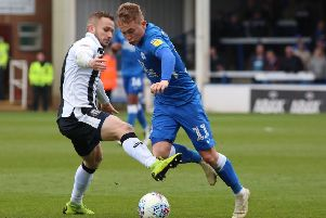 Louis Reed in action for Posh last season.