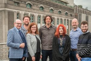 John D'arcy, Davy Matchett, Gary Lightbody (all Lightbody Foundation) and Andrew McCracken, Chief Executive, Community Foundation for Northern Ireland, pictured with Tricia Kelly, Youthlife and two young people from the charity, Serena Shiels and Caleb Griffin.