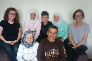 Feras and Asmaa (front), their family Sedra, Adel and Shaimaa, with Siobhan Shiels, Inishowen Together and Gayle Green.