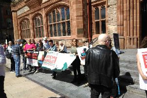 Welfare Reform protesters pictured outside the meeting in the Guildhall.