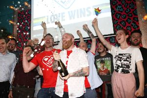 Members of the LGBT community celebrate at the Maverick bar, Belfast, as same-sex marriage in Northern Ireland came a step closer after MPs voted to legalise it if a new Stormont Executive is not formed by October. Photo: Peter Morrison/PA Wire
