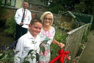 Rosina Rogers and Finlay Billingsley prepare to officially open Brownlow Primary School's new sensory garden with head Damien Turrell EMN-190715-144724001