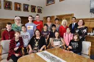 The Mayor, Councillor Michaela Boyle pictured with children from Chernobyl and host familes when she hosted a recent reception in the Guildhall. Included is Alderman Ryan McCready. DER2919-140KM