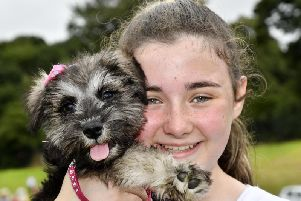 Holly Bradley pictured with her puppy Madge during  a previous Pooches in the Park event. DER3018-102KM
