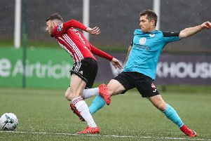 Derry City goalscorer, Jamie McDonagh skips away from the challenge of Sligo Rovers' Ronan Murray