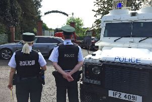 Police and army bomb disposal experts at Shandon Park Golf Club in east Belfast after the suspect device was found under a police officer's car. Photo: David Young/PA Wire