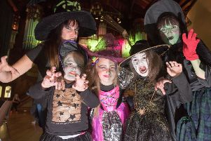 Winifred the Witch, right who cast a spell to summon, Trish Taylor, Ria Hanna, 5, Clara Gillespie, 9, and Tess Taylor, 7, with the hundreds of witches who descended on the Walls of Derry as Derry City and Strabane District Council launched its Hallowe'en programme last year. Picture Martin McKeown. Inpresspics.com. 16.08.18