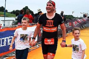 Paul Thorpe with his two children Joseph and Izzy on the finish chute EMN-190108-121607002