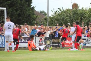 Joel Carta heads off to celebrate after scoring Kettering Town's first goal in their 2-1 victory over AFC Telford United. Pictures by Peter Short