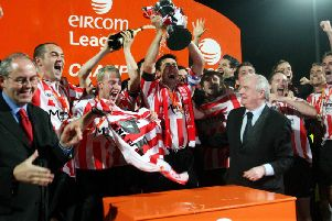 Derry City players celebrate after receiving the eircom league cup in September 2006 after the penalty shootout win over Shelbourne at Brandywell.