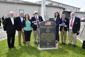 The Mayor, Councillor Michaela Boyle and U.S. Consul General to Belfast, Elizabeth Kennedy Trudeau, pictured with members of the United States Naval Communications Station Londonderry Northern Ireland Alumni Association, from left, James Sullivan, President, John Reigle, Vice President, Ted Nevels, Secretary, Frank Ekstrom, and Dennis Kolodziej, Treasurer, after the unveiling of the memorial in the grounds of Foyle College on Tuesday. DER3119-103KM